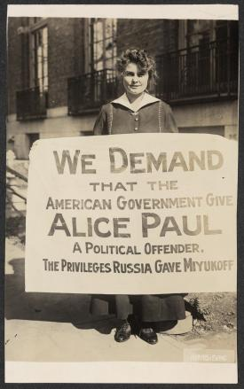Lucy Branham with Russia Banner